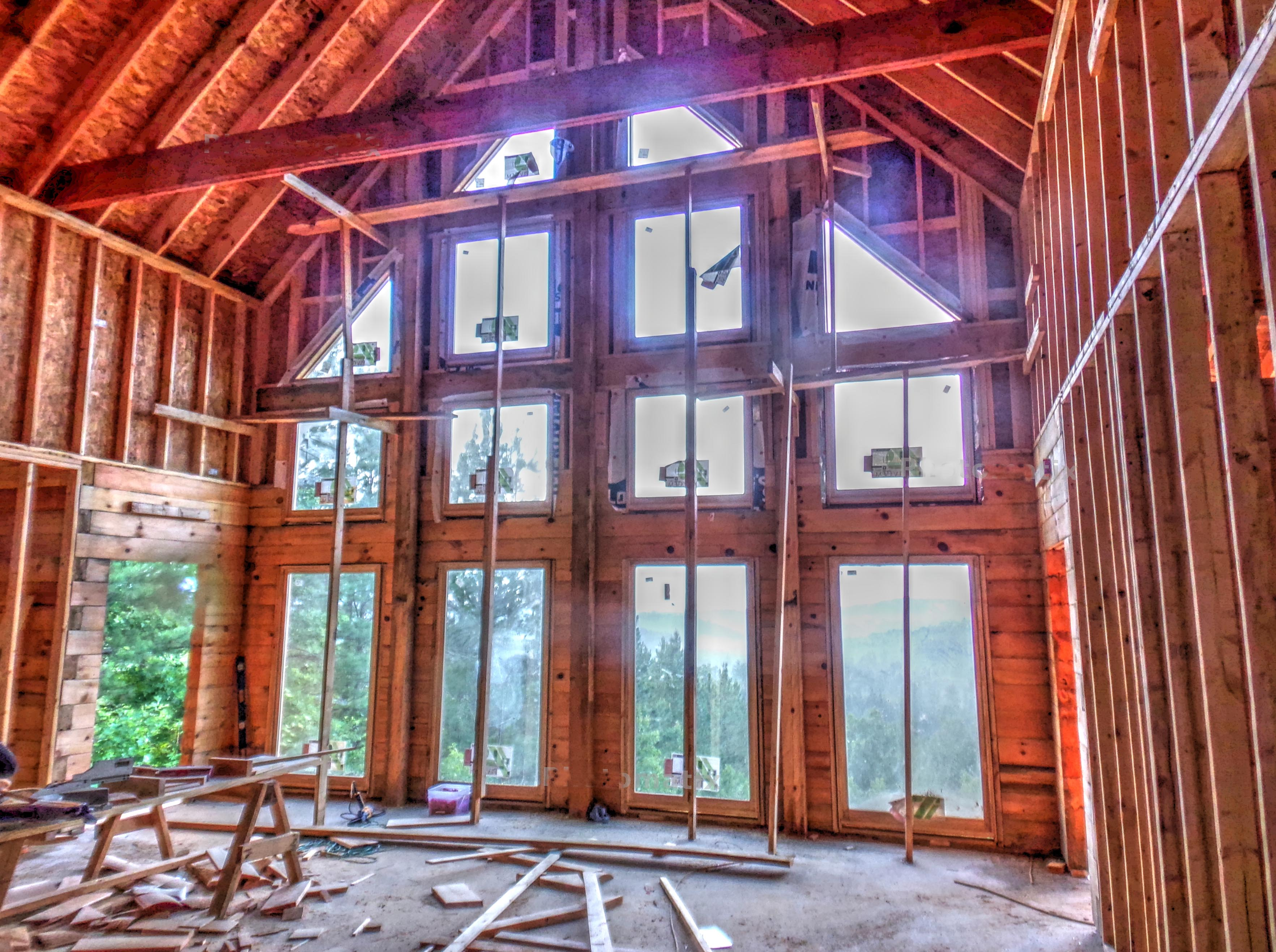 A log home rises on brushy top mountain living in the for Log home windows