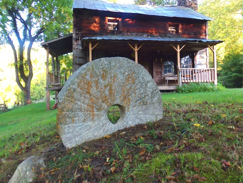One of two Mill Stones in the front yard.